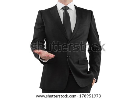 businessman in suit showing something on a white background