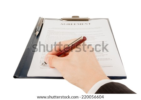 Businessman in suit signing the contract (agreement)
