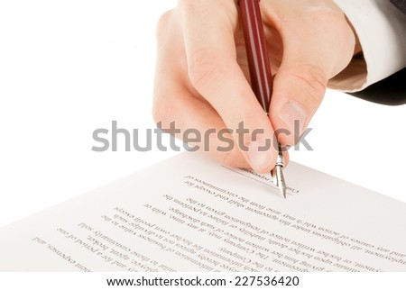 Businessman in suit signing the contract (agreement) - stock photo