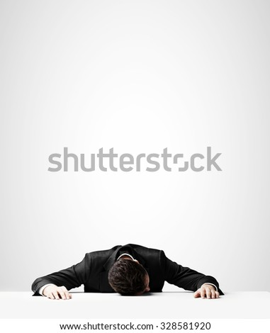 businessman in suit sleeping on table - stock photo
