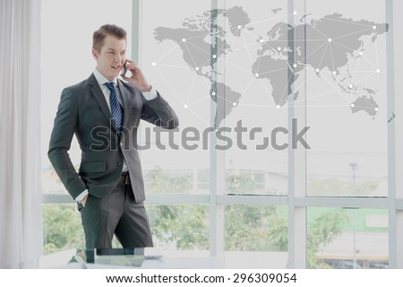 businessman in suit speaking on mobile phone, business globalization concept - stock photo