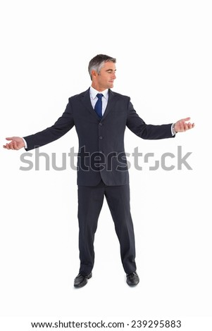 Businessman in suit spreading his arms on white background