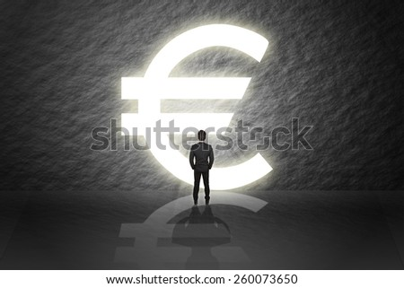 Businessman in suit standing and looking aim the gate(door) success euro pound money sign isolated cement abstract background. - stock photo