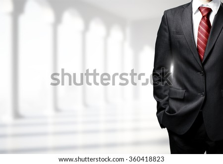 businessman in suit standing in room