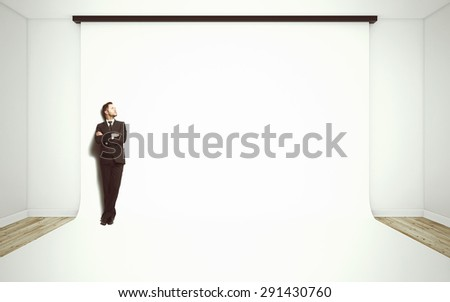 businessman in suit standing in studio - stock photo