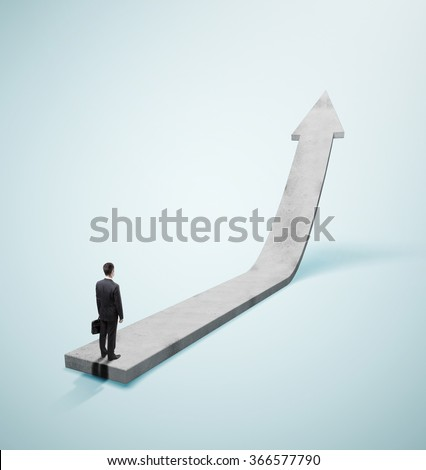 businessman in suit standing on gray arrow