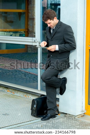businessman in suit using tablet PC