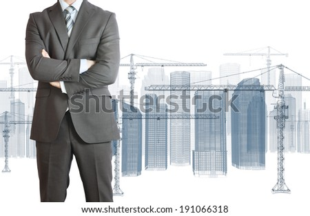 Businessman in suit. Wire frame tower crane and skyscrapers on the background - stock photo