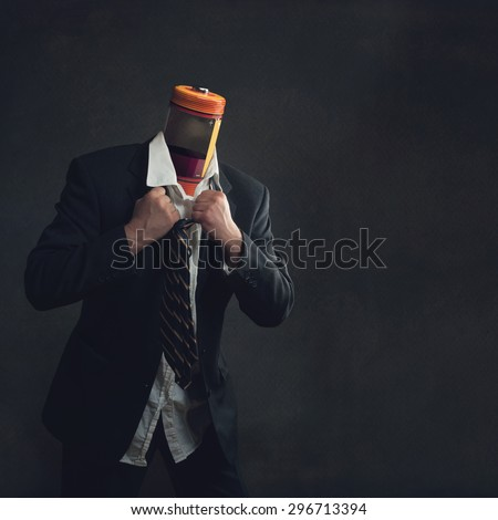 Businessman in Suit with a battery as head - stock photo
