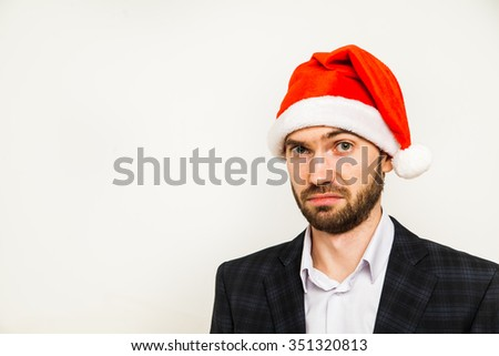 Businessman in suit with santa hat on head. Isolated over white background man beard business suit christmas cap