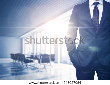 Businessman in sunny office - stock photo