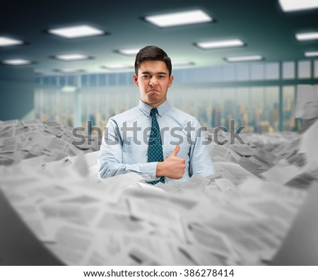 Businessman in the heap of papers - stock photo