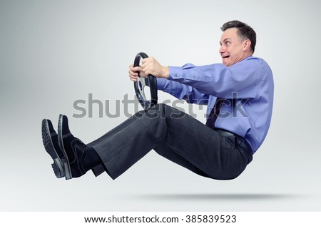 Businessman in tie car driver with a steering wheel