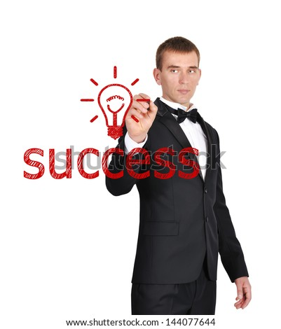 businessman in tuxedo drawing success symbol