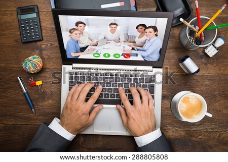 Businessman In Video Chatting With His Colleagues On Laptop - stock photo