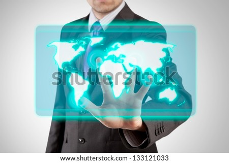 businessman interacting with toushscreen virtual display