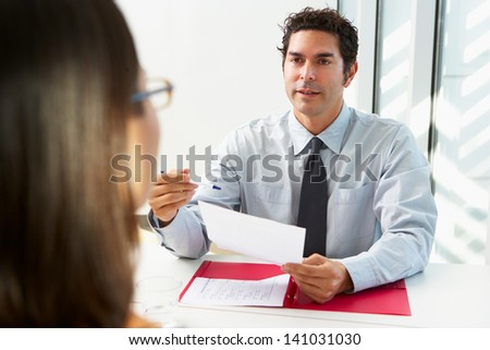 Businessman Interviewing Female Candidate For Job - stock photo