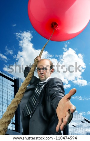 Businessman inviting you to fly up by big red balloon - stock photo
