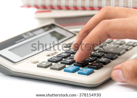 Businessman is calculating and working, a lot of documentation is waiting to be processed - stock photo
