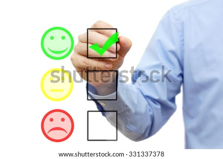 businessman is choosing smile on checklist, customer satisfaction concept - stock photo