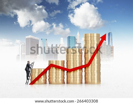 Businessman is climbing to the financial success over New York landscape - stock photo