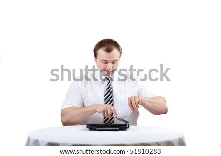 Businessman is cutting notebook for lunch - stock photo