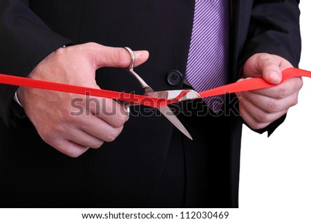 businessman is cutting red ribbon