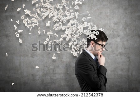 Businessman is developing a new strategy to start up a new business and trying to assess the risks. Flying letters.  - stock photo