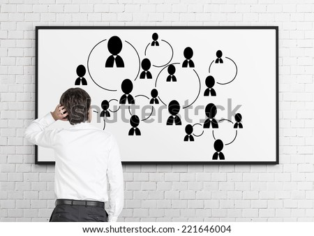 Businessman is developing social media system, network connections. - stock photo
