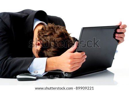Businessman is distraught and puts his head down in disbelief after hearing news of the global recession - stock photo