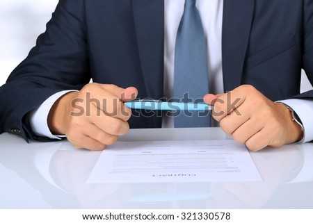 Businessman is doubting  about signing  a contract, business contract details