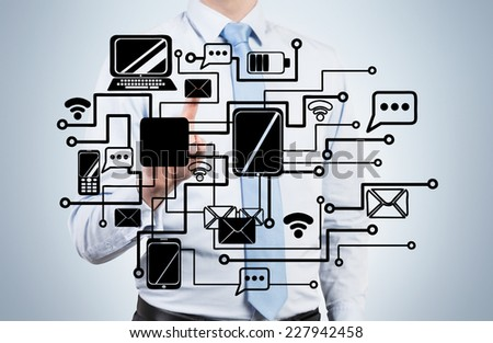 Businessman is drawing a corporate internal network. - stock photo