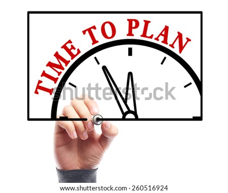 Businessman is drawing the concept of time to plan on transparent white board. - stock photo