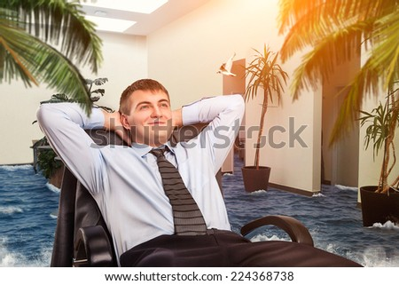 Businessman is dreaming about vacations - stock photo