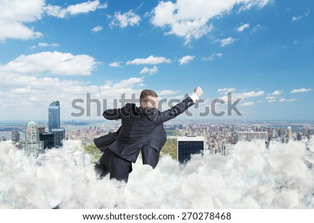Businessman is flying over the central park in New York through the cloud - stock photo