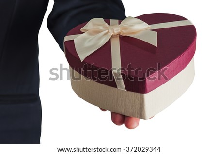Businessman is giving heart box gift isolated over white - stock photo
