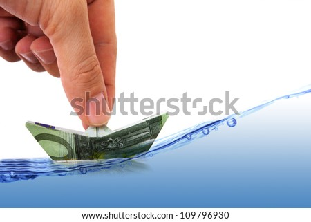 businessman is guiding money boat on rough sea - stock photo