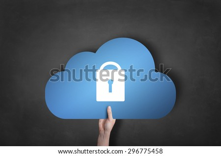 Businessman is holding a blue cloud lock icon on black blackboard - stock photo