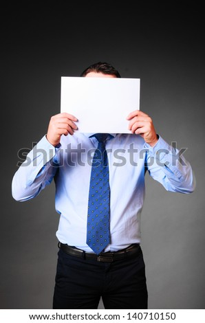 businessman is holding blank banner in hands