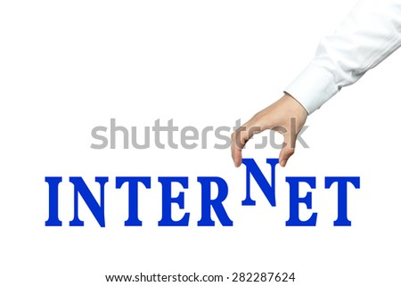 Businessman is holding the text of Internet isolated on white background. - stock photo