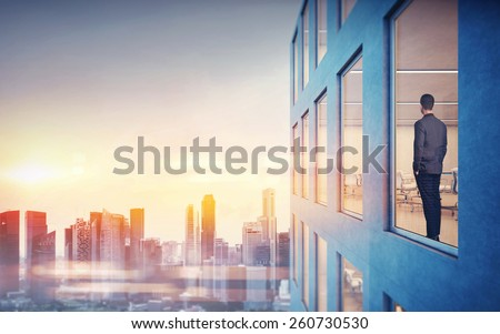 Businessman is looking at city  - stock photo