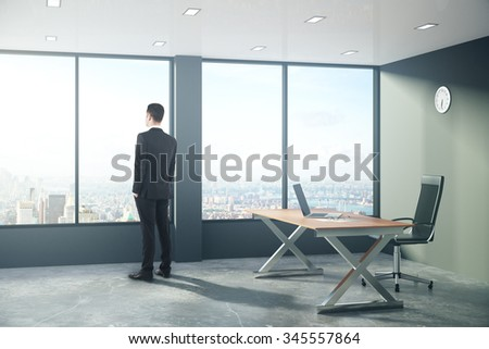 Businessman is looking out the window in modern loft style office 3D Render - stock photo
