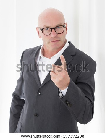 businessman is pointing his finger - stock photo