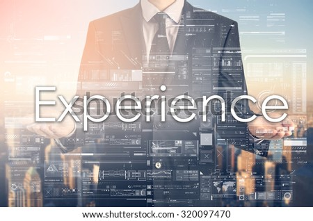 Businessman is presenting text: Experience - stock photo