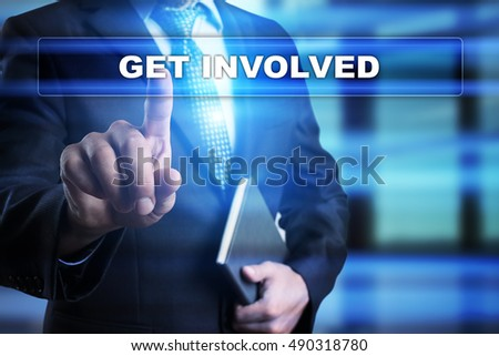 "Businessman is pressing button on touch screen interface and selecting ""Get involved"". Business concept."