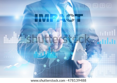 "Businessman is pressing button on touch screen interface and selecting ""Impact""."