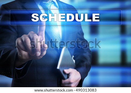 "Businessman is pressing button on touch screen interface and selecting ""Schedule"". Business concept."