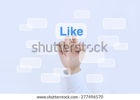 Businessman is pressing the like button on the transparent screen.