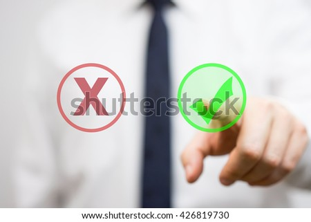 businessman is pressing virtual check mark - stock photo