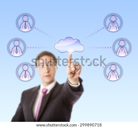 Businessman is reaching out to connect with white collar workers via a virtual network. His left index finger is touching a cloud icon linked to three male and three female peers to each side. - stock photo